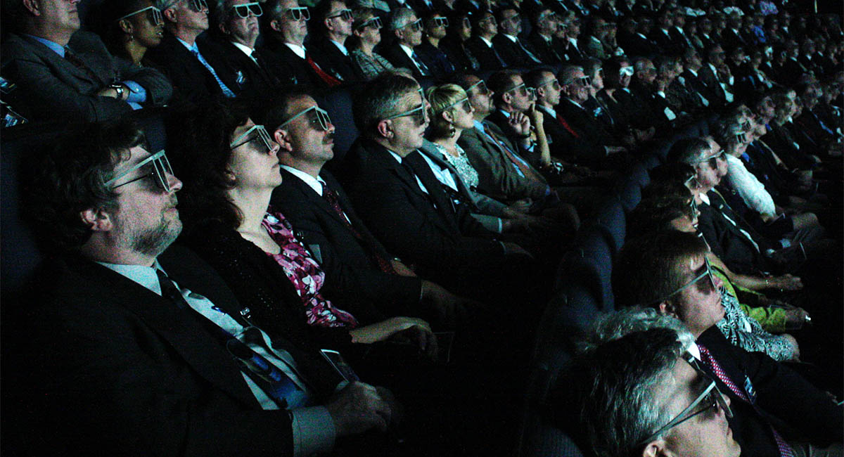 Movie theater, people wearing 3D glasses