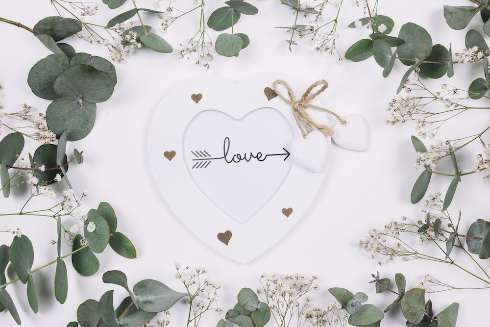 Word love in heart with floral accents