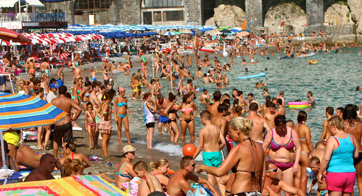 Crowded beach in Amalfi, Italy