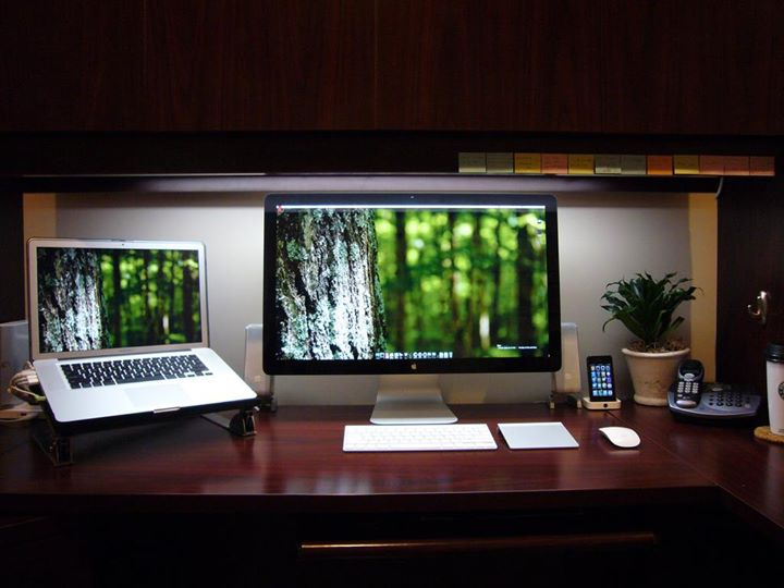 A neat desk with computers