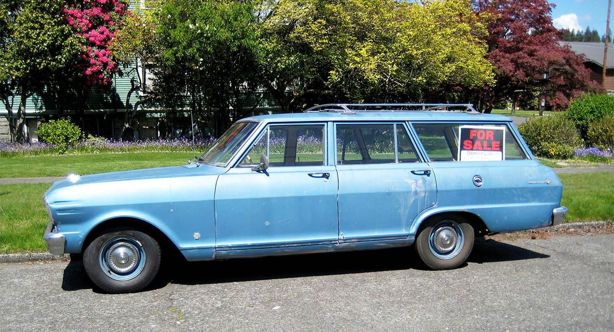 Blue car, station wagon, for sale sign