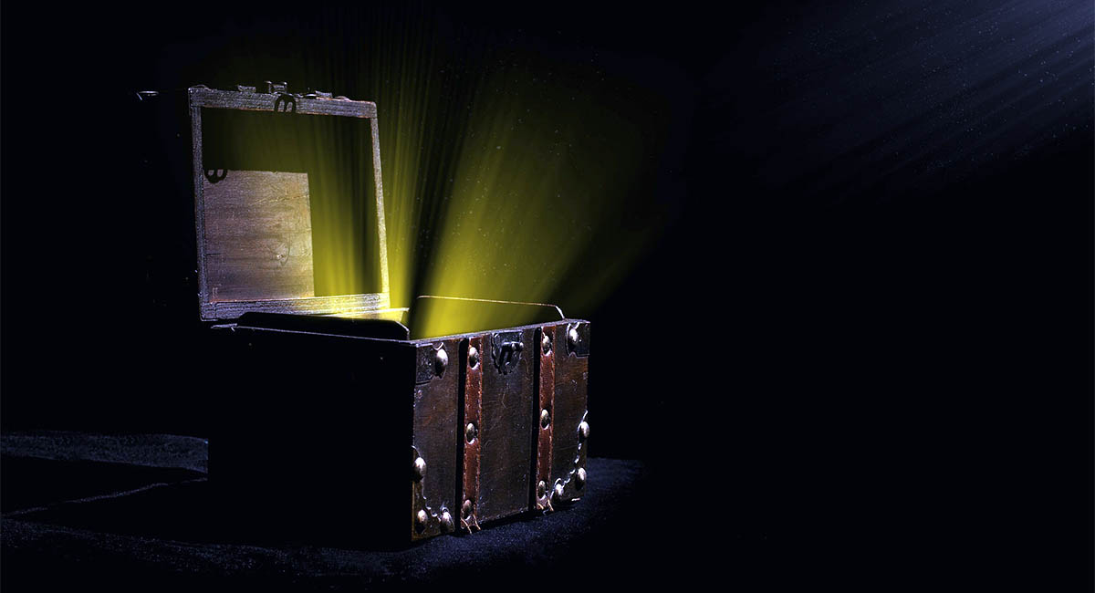 Treasure chest open with gold light shining out
