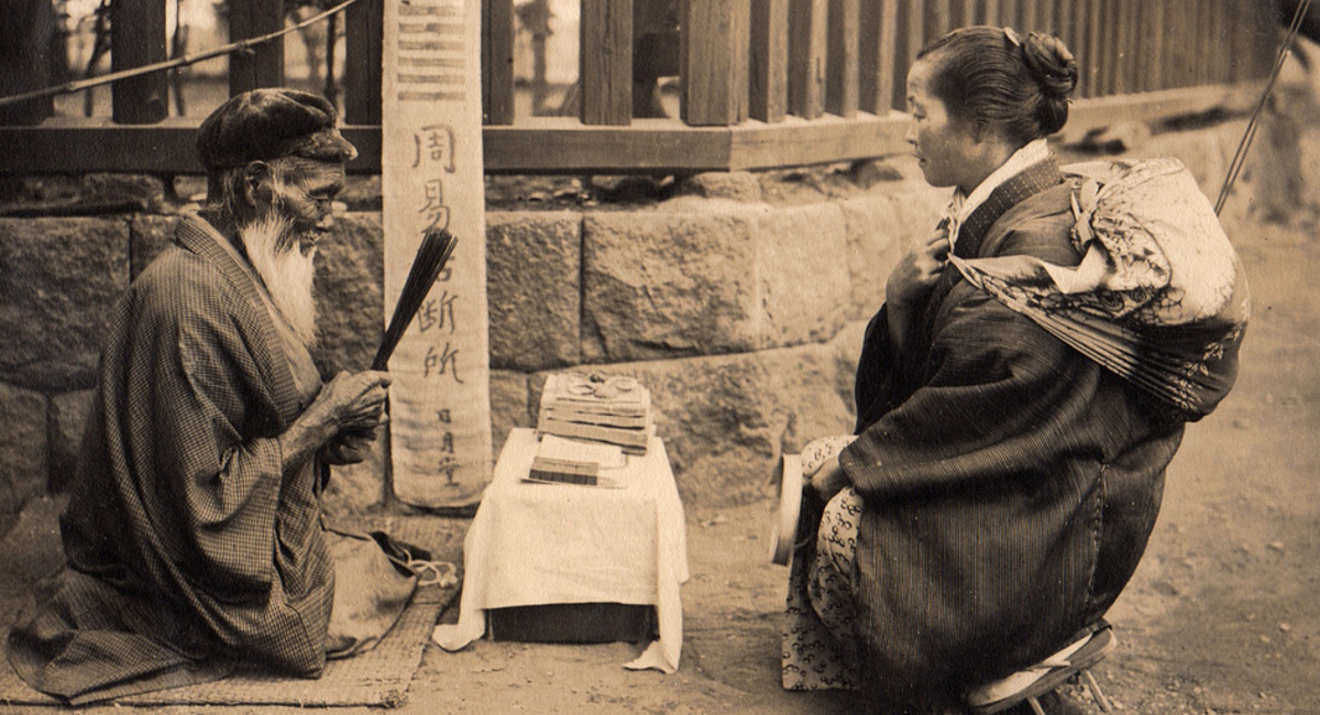 An old photo of a Japanese fortune teller