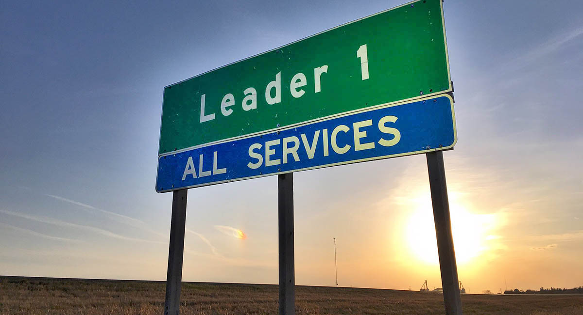 """Highway exit sign """"Leader 1 All Services"""""""