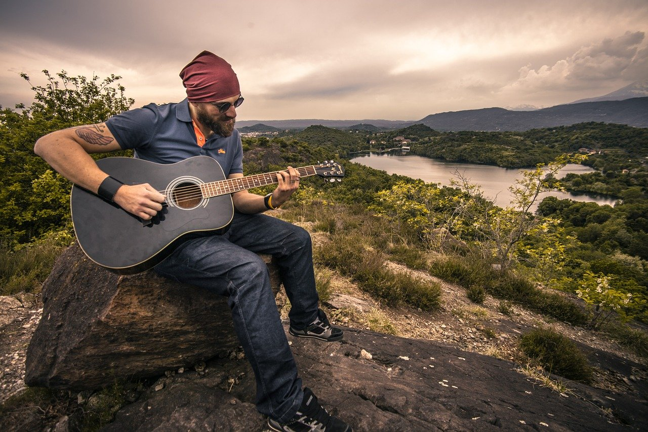 Man playing guitar in nature
