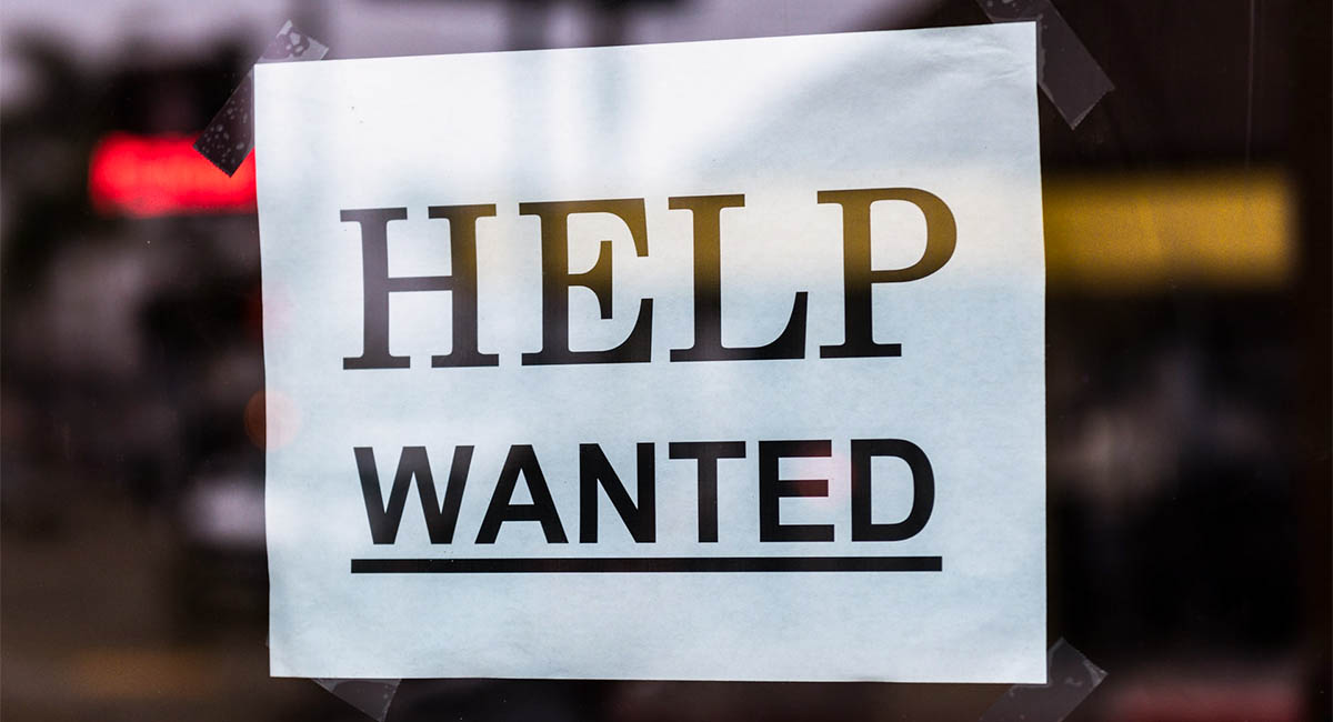 Help Wanted sign on shop door
