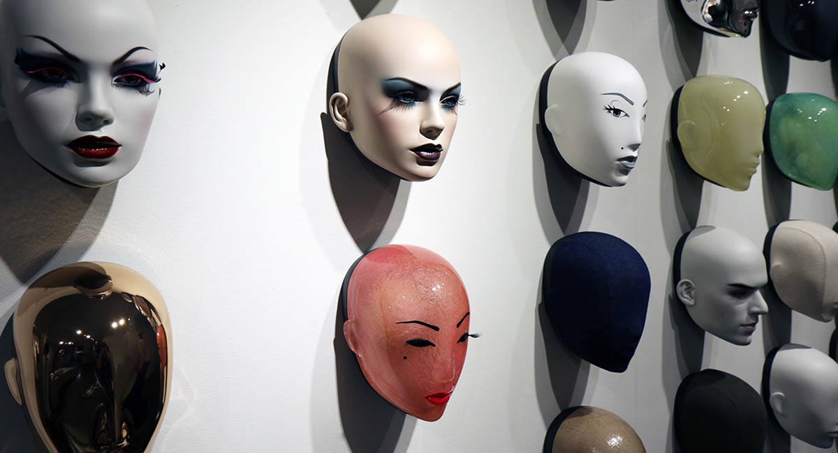 Mannequin heads on a wall