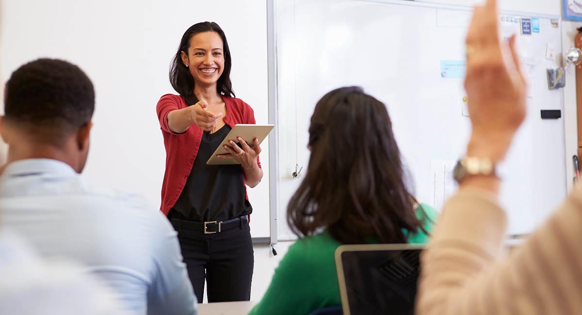 Woman teaching class of adults