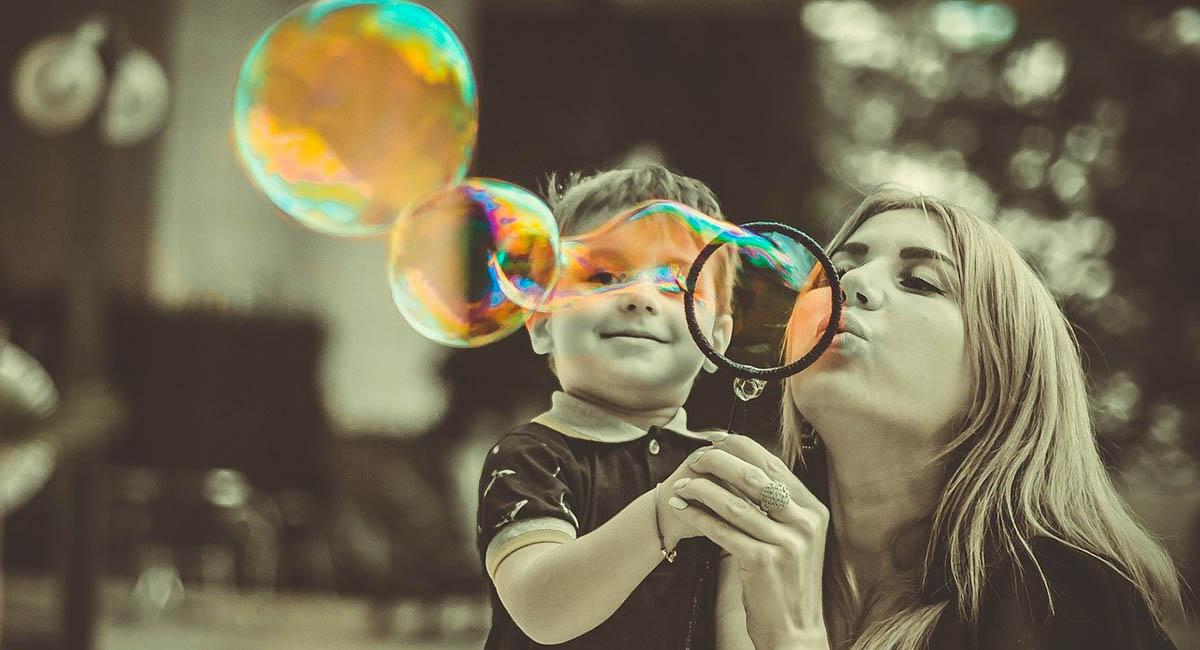 boy with mother blowing bubbles