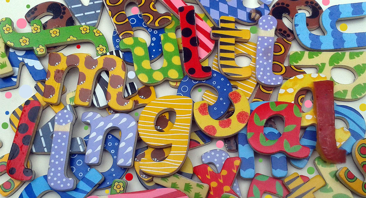 Multilingual spelled with wooden letter shapes in a pile