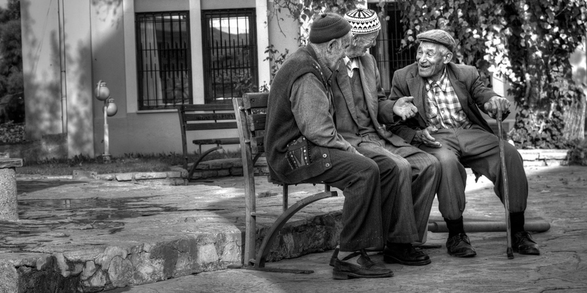Old friends sitting on a park bench