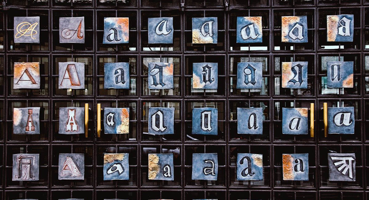 Typesetting letter A in different fonts