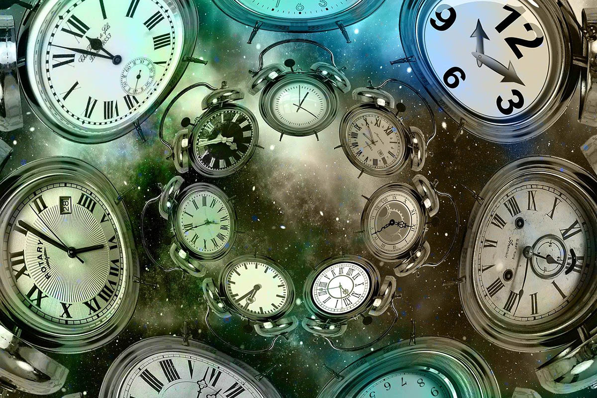 clocks set to different times swirling into galazy