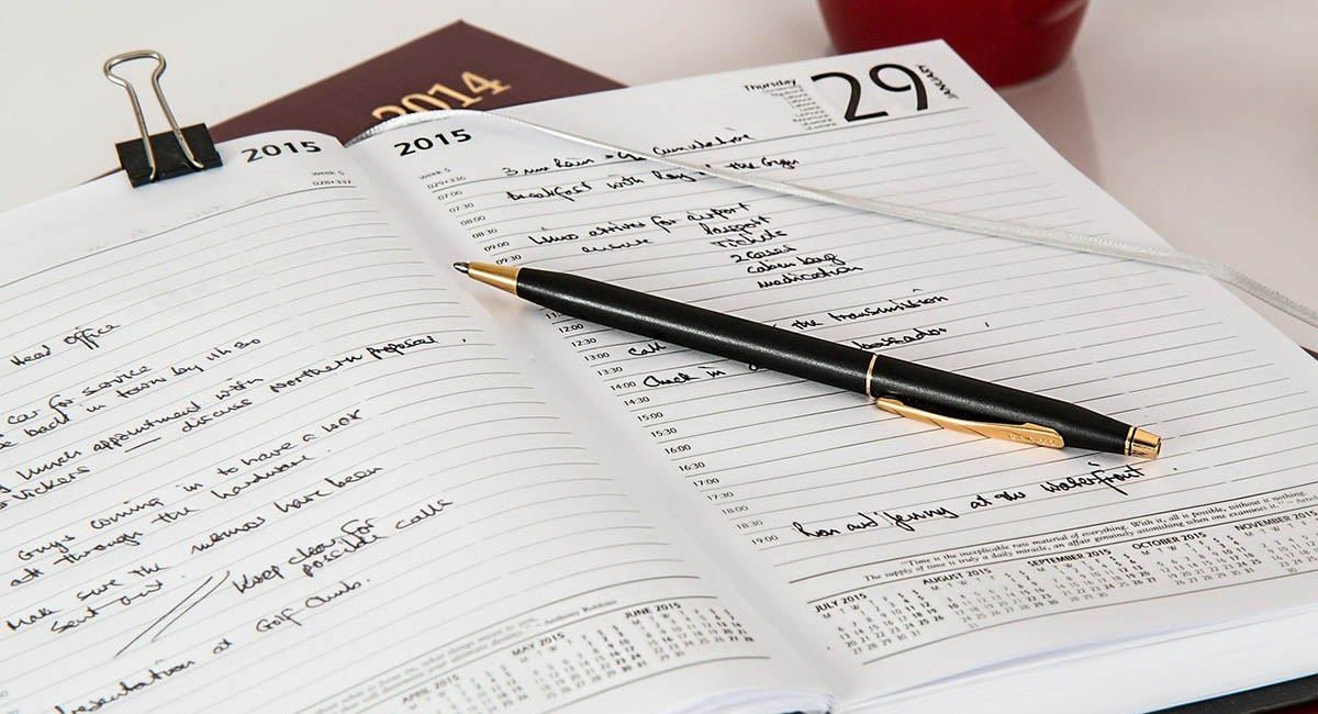 Daily planner open with pen on top