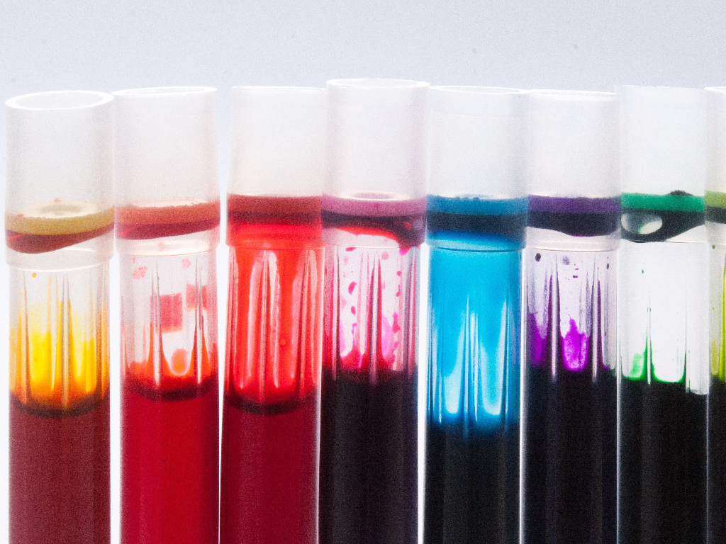 Test tubes full of brighly colored paint