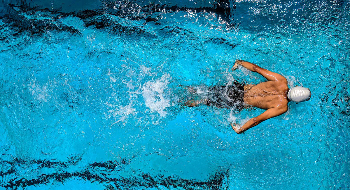 Man doing the breaststroke in a swimming pool