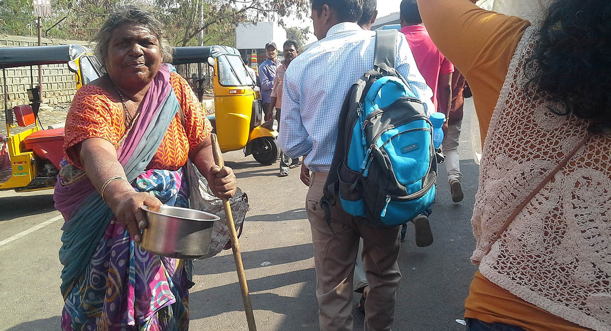 An elderly woman begging on streets of Hyderabad