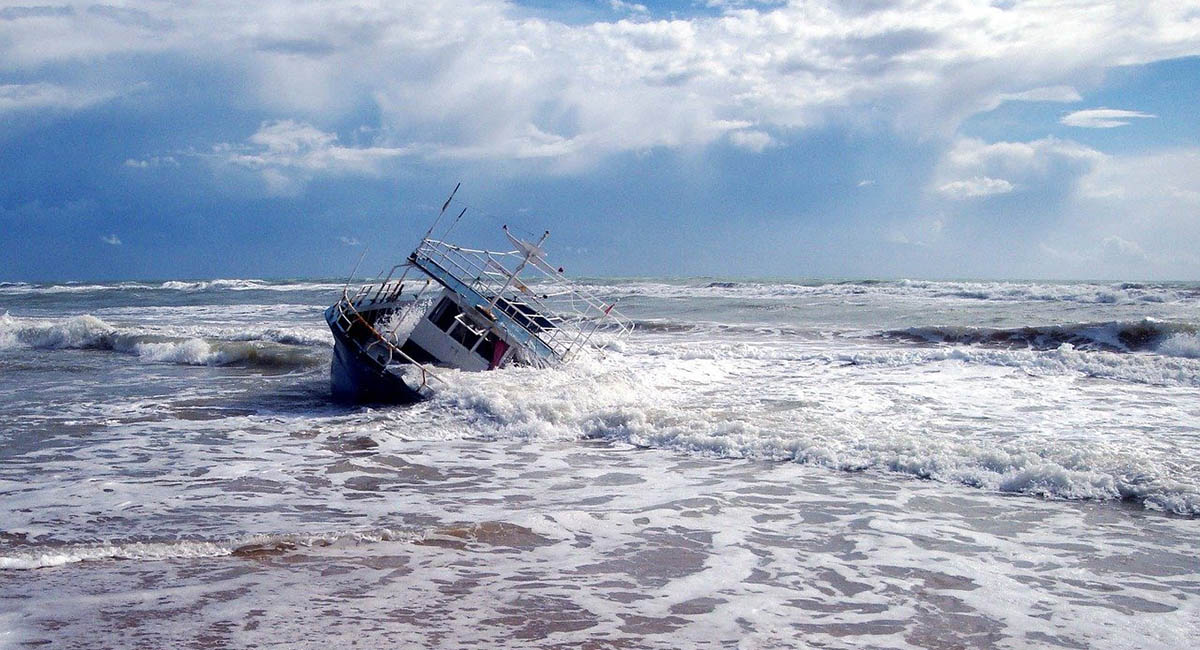 Yacht wrecked on shore