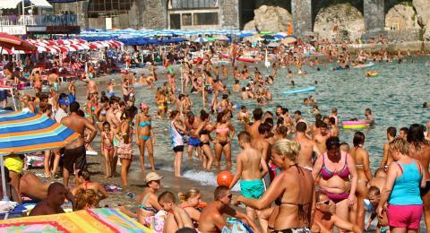 Crowded beach in Amalfi, Italy