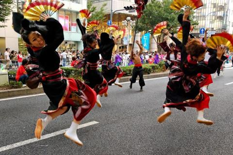 Fan dancers in a parade