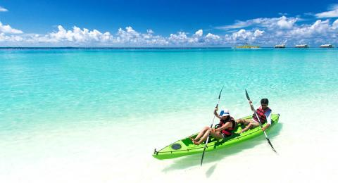 Two-person kayaking in the Maldives