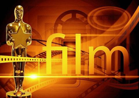 """Award statue with film graphics and word """"film"""""""