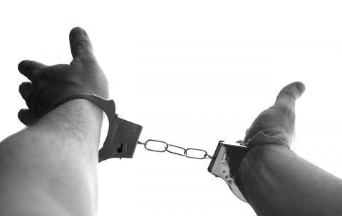 Man's wrists in handcuffs