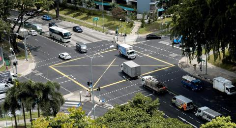 Intersection with cars, trucks, and buses