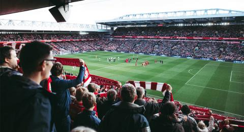 Fans in a stadium watching a Liverpool football game