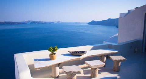 Table on balcony overlooking the sea in Greece