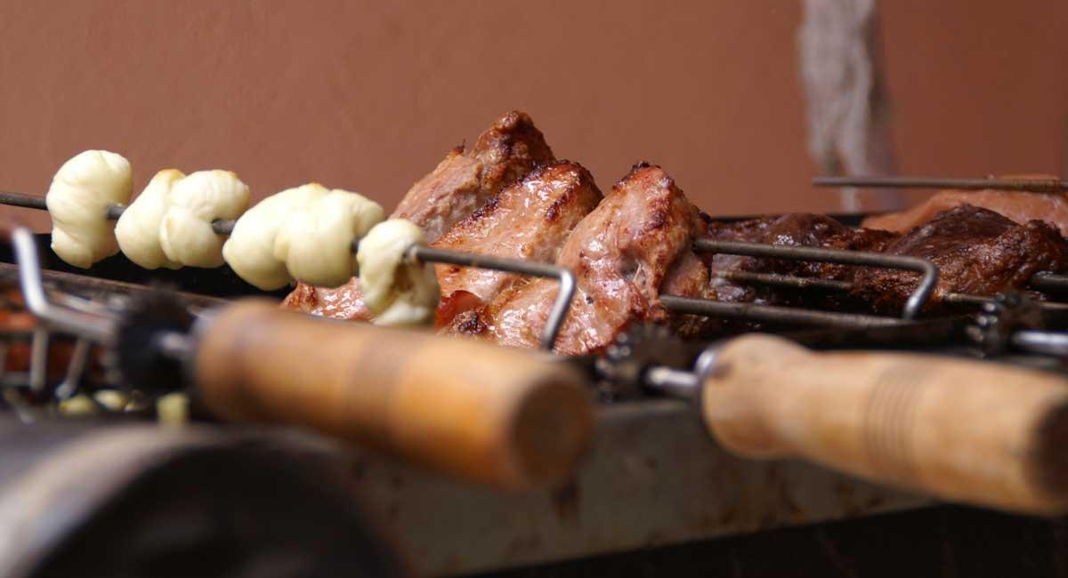 A picture of meat on a Brazilian style barbecue