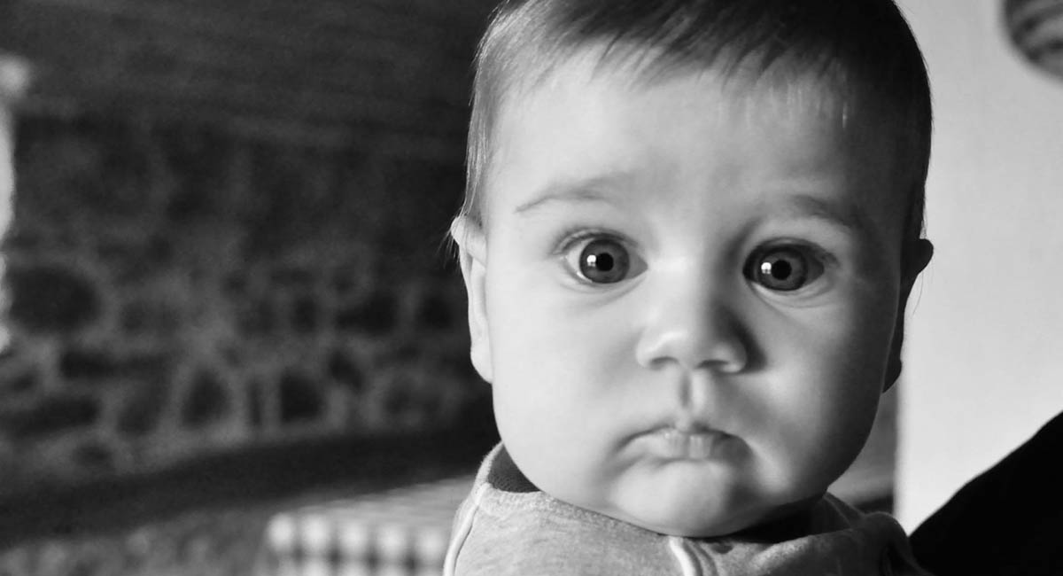 Baby with surprised look, black and white