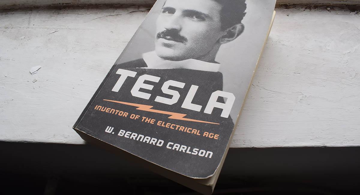 Book on shelf, biography of Tesla