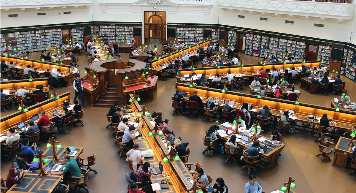 Overhead view of students at work in a large university library
