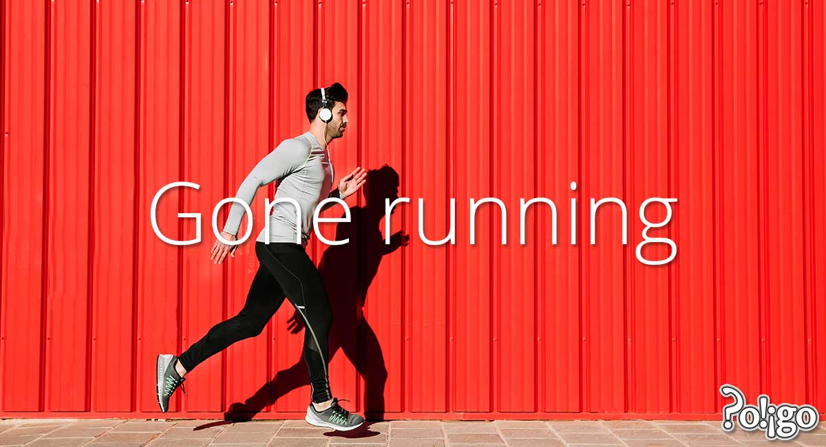Man running in front of red wall