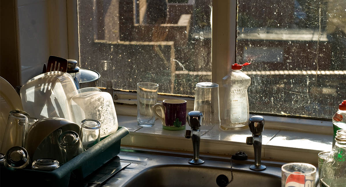 Dirty kitchen windows over a sink