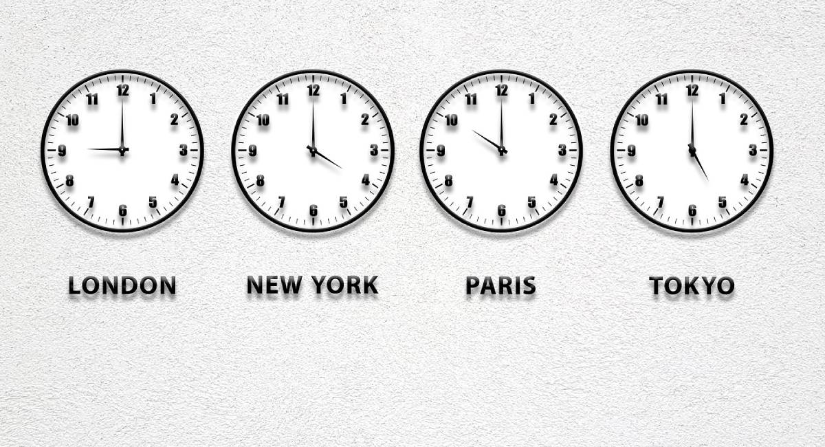 World times shown on 4 clocks on a wall